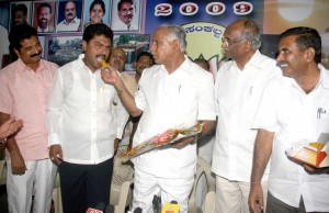 cm-giving-sweets-to-his-elected-son