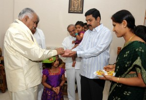 Chief Minister B S Yaddyurappa distributed prasada to family members after performing Ganesha Pooja.son Vijeyendra Daughter Padma Grand Daughter Jhansy seen in pic