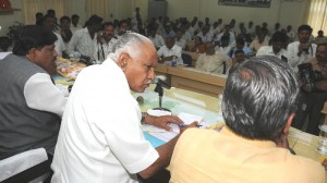 Chief Minister B S Yeddyurappa reviewed Bagalakote Dist DCC Bank New Building.Ministers Murugesh R Nirani,Govind Karjol seen in pic
