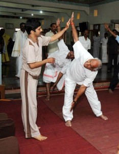 Chief Minister B S Yeddyurappa performing Yoga @ Sutturu Yoga Teacher Nagendra Kamat seen in pic
