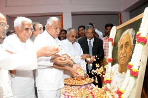 Cm offered flowers to KUVemPu Portrait