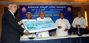 Chief Minister B S Yeddyurappa handing over KPC Dividend Cheque of Rs 14.86 Crores to Government of Karnataka.,.PWD Minister CM Udasi,Energy Minister K S Eshvarappa seen in pic