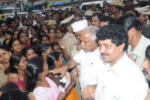 CM hearing grieve from a woman at Krishnananda Nagar