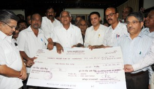 Labour Minister B N Bachchegowda presented 8 Crores from labour department to Chief Minister B S Yeddyurappa for CM calamity relief fund