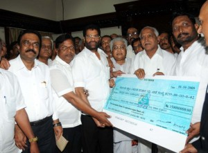 Sri Lakshman Savadi,Minister for co operative presented Rs 15 crore cheque to Chief minister on 11.10.220. For Flood relief fund on Behalf of All co operative and Apex Banks.