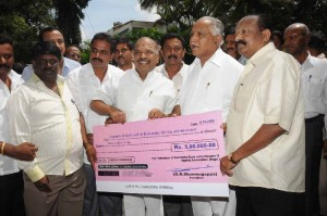Sri Shanmukappa ,chairman of Truck Association presented Rs 5 lakhs cheque to calamity fund