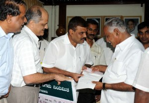 Sri S N Manmatha, chairman of karnataka forest Development Limited presented rs 2 crore cheque to chief minister relief fund (calamity) on 12.10.2009
