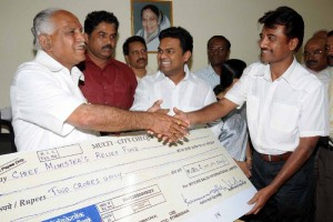 Sri Vikram Patil,chairman of MSIL and Sri Shivram, MD presented Rs 2crore cheque to CM,s calamity fund  on 09.10.2009