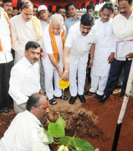 Chief Minister B S Yeddyurappa & Revenue Minister Karunakara Reddy plated a tree @ Kakkaragola Village @ laying foundation for Shifting of Nandihally,Kakkaragola,Shaliganuru,Karadola & Kuntgavatioji  villages in Gangavati Tq Koppala Dist.Revenue Minister Karunakara Reddy,Dist Minister Govind Karjola,Agriculture Marketing Minister Shivaraj Tangadagi,MP Anantha Kumar,Shivarame Gowda  seen in pic