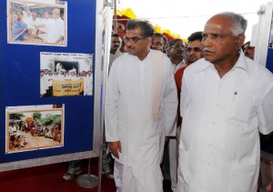 Chief Minister B S Yeddyurappa & Dharmastala Veerendra Hegde visited Floods Photo Exhibition @ Arehatty Village Shifting & Construction Foundation function Mahendra Mishra Director T V 9 seen in pic