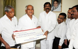 Labour Minister B N Bachegowda presented Cheque of Rs 11  Crores to Chief Minister B S Yeddyurappa  for CM calamity relief Fund