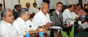 Chief minister B S Yeddyurappa Discussing with officers in a meeting of to prepare a  proposal on infra structure development in fllod affected areas to be submitted to central Govt,Sri Govinda Karjol, minister for minor irrigation, Sri  V S Acharya, minister for home,Sri S V Ranganath,chief secretary,Sri Basavaraj Bommai,minister for major irrigation and Kum Shoba Karindajle ,minister for RDPR were present.
