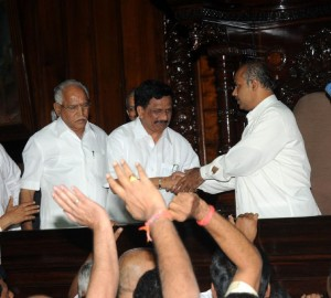Chief Minister B S yeddyurappa,escorting Newly elected speakar  K G Bopaiah To The chair