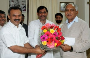 Sri Shivanna and SRi Suresh Gowda met cm.jpg 2