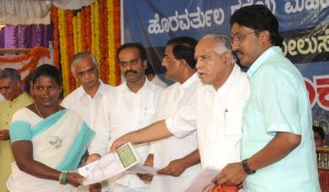 Chief minister B S Yeddyurappa distributed the Kath certificates to the benificent at K R Purum assembly constituency on 05.12.2009
