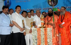 Chief minister Sri B S Yeddyurappa lighting the lamp to mark the inauguration of Sri Someshwara Sabha Bavana in Bangalore on 06.12.2009. Sri Rambapuri Jagad guru Baalehonnur,sri M V Rajashekar ex central minister and Si Renukacharya ,MLA were present