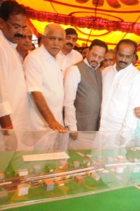 chief minister B S yeddyurappa inspecting the key model of signal free outer ring road at K R Pura assembly constituency on 05.12.2009