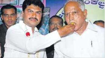 Credits son Raghavendra's victory in polls to committed BJP workers