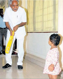 BS Yeddyurappa playing with his granddaughter