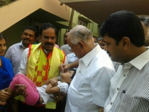 Administering Polio Drops at Shimoga in the morning on National Immunization Day.